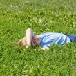 Boy have fun in green grass. — Stock fotografie