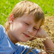 Boy have a rest on the haystack. — Stock Photo