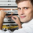 Stock Photo: Engineer in datprocessing center of ISP Internet Service Provider h