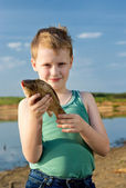 The young fisherman. First fish. — Stock Photo
