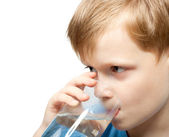 Little boy drink cold water from the glass. Closeup. — Stock Photo
