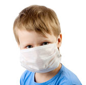 Flu illness child boy in medicine healthcare surgical mask isolated over wh — Stock Photo