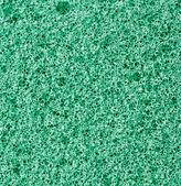 Gröna textur skum svamp. bakgrund. — Stockfoto