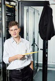 The engineer in suit stand in datacenter near telecomunication equipment ho — Stock Photo