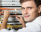 The engineer in a data processing center of ISP Internet Service Provider h — Stock Photo