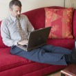 Business man working in hotel room — Stock Photo