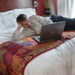 Business man working on bed — Stock Photo #10507989