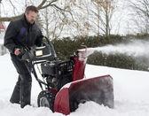 Man using snow blower — Stock Photo