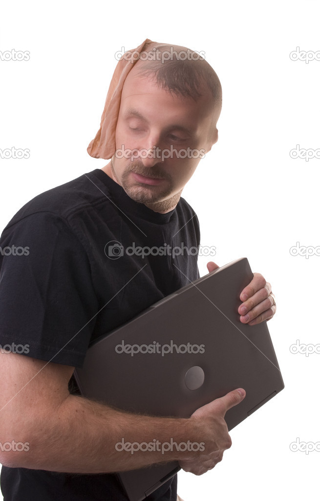 Thief stealing a laptop - computer theft  Stock Photo #10507794