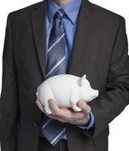 Homem de negócios com o banco piggy — Foto Stock