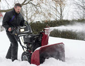 Man operating snow blower — Stock Photo