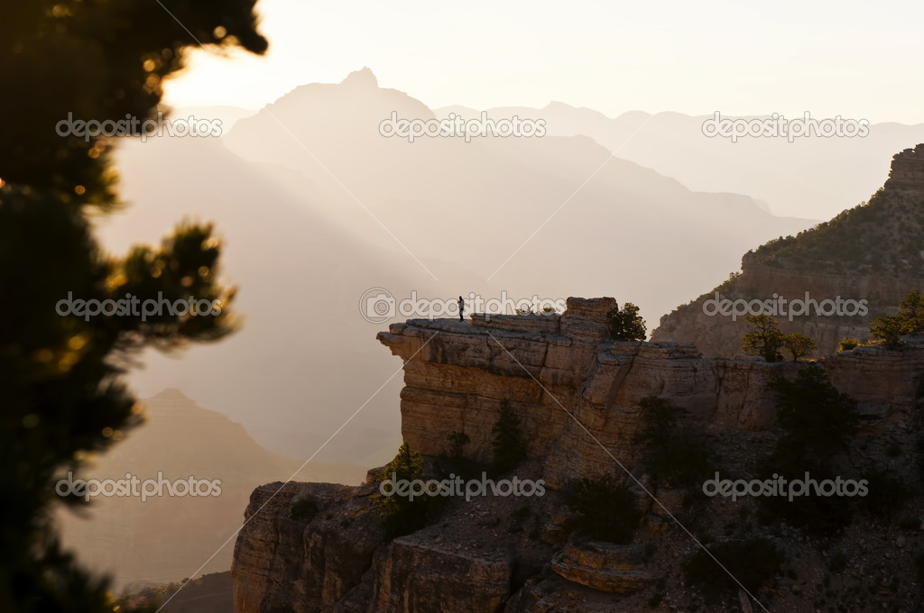 Image of a lone person looking out over an early mornig view of the Grand Canyon — Stock Photo #10350158