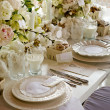 White wedding Banquet Table With Milk & Doughnuts - Stock Photo