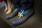 Grungy shoes with flower decorations — Stock Photo