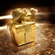 Gold gift on silver tray — Stock Photo #8949991