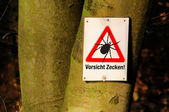 Tick warning — Stock Photo