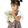 Little girl counting money — Stock Photo