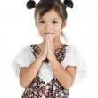 Cute Asian girl with folded hands — Stock Photo