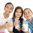 Asian kids with milk — Stock Photo