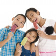 Siblings eating ice creams — Stock Photo