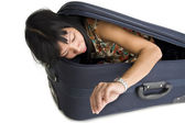 Woman in luggage checking time — Stock Photo