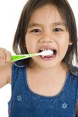 Little asian girl brushing her teeth — Stock Photo