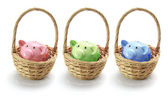 Piggy Banks in Baskets — Stock Photo