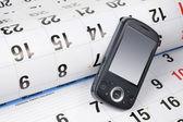 Smart Phone on Calendar — Stock Photo