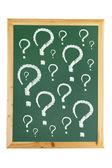Tablica z znaki zapytania — Zdjęcie stockowe