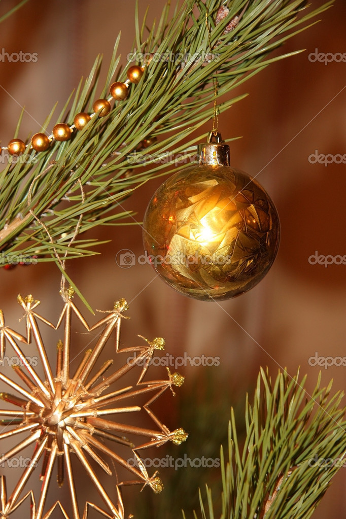 Gold Christmas ball on the Christmasthree — Stock Photo #8081282