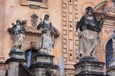 Sculptures on the fasade of the old church — Stock Photo