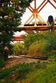 Railroad under railway bridge — Stock Photo