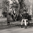 Teenage girl and boy on bench — Stock Photo