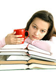 Teenage girl with books and tea — Stock Photo