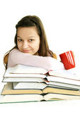 Happy teenage girl with books and tea — Stockfoto