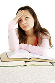 Teenage girl dreaming over books — Stock Photo