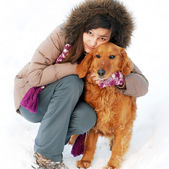 Smiling girl and her dog — Stockfoto