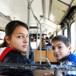 Boy and girl in city bus — Stock Photo #9290547