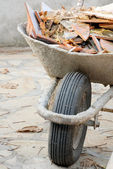 Wheelbarrow with waste — Stock Photo