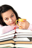 Teenage girl with books and cup — Stockfoto