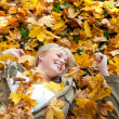 Young womlying in autumn leaves — Stock Photo #7971182