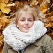 Young woman lying in autumn leaves — Stock Photo