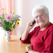 Old womwith cell phone — Stock Photo #8600834