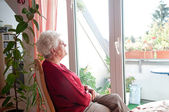 Lonely old woman — Stock Photo