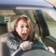 Stock Photo: Afraid womscreaming in car