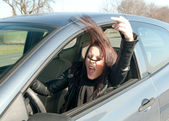 Woman in the car shows the middle finger — Stock Photo