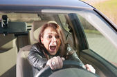 Afraid woman screaming in the car — Stock Photo
