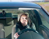 Afraid woman in the car — Stock Photo