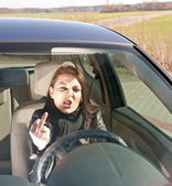 Woman in the car shows the middlefinger — Stock Photo