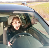 Annoyed woman in the car — Stock Photo